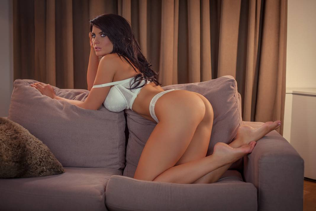 Busty girls , Lana Dealessi on the couch